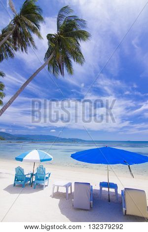 Koh Tan beautiful Coconut trees jutting out into the sea and beach chair. Koh Samui Thailamd.