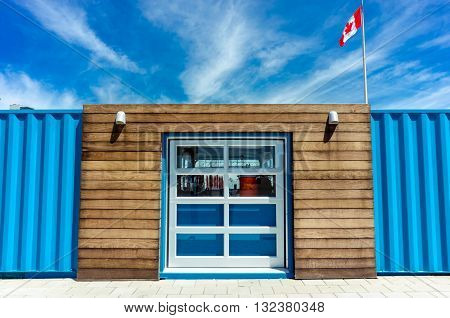Big window between two ship containers in canadian territory horizontal