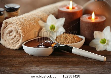 Spa chocolate set with candles on blurred background