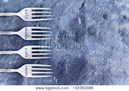 Blue Textured Background With Silver Forks