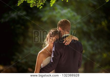 Bride and groom on their wedding day In garden