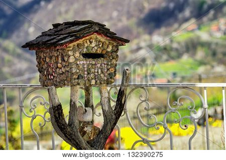 Decorative stone Postbox in a mountain house