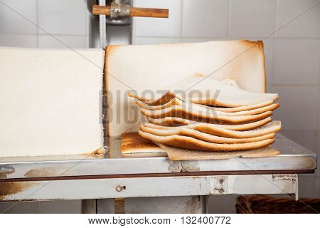 Bread Loaves With Unwanted Slices On Cutting Machine Table