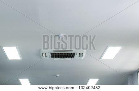 Smoke detector on white office ceiling.Office Ceiling Plastic White.