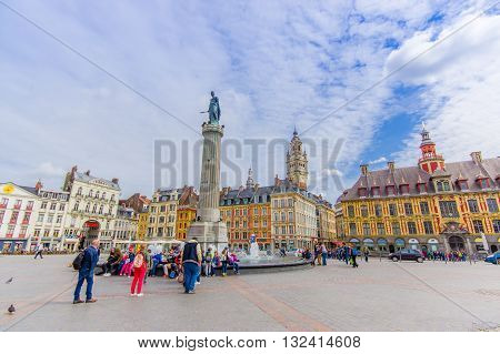 Lille, France - June 3, 2015: Beautiful Place Grande with its charming buildings and traditional european architecture sorrounding the plaza on a nice summer day.