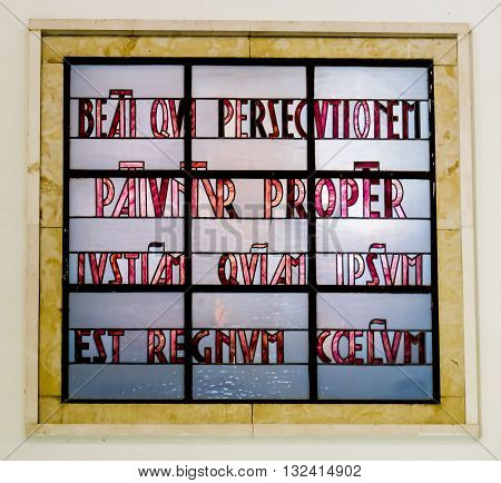 Mount of Beatitudes. Israel. July 9 2015: Blessed are those who are persecuted... . Stained glass in the Catholic chapel on Mount of Beatitudes near Tabgha at the Sea of Galilee Israel