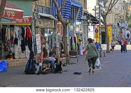 TEL AVIV, ISRAEL - APRIL 3, 2016: People and street musicians at old Nahalat Binyamin district, Tel Aviv, Israel.