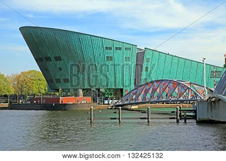AMSTERDAM, NETHERLANDS - MAY 6, 2016: Science Museum NEMO designed by Renzo Piano (1997) - largest childrens science educational museum knowledge institute and center of tourism in Amsterdam, Netherlands.