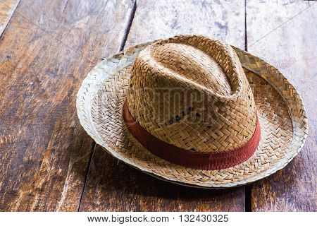 Brown headgear placed on the wooden background.