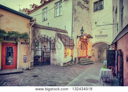 Tallinn Estonia - May 30 2016: medieval street Saiakang 2 and restaurant Balthasar in the Historical Centre of Tallinn city. Tallin Estonia.