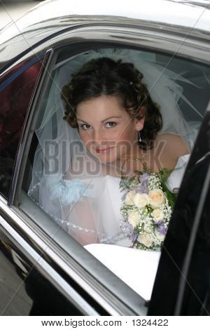 Young Bride In A Veil And With A Bouquet