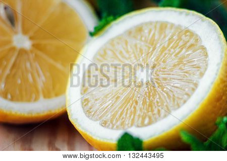 Juicy yellow fresh lemon on an old vintage wooden table