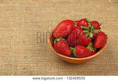Strawberry In Ceramic Bowl On Jute Canvas