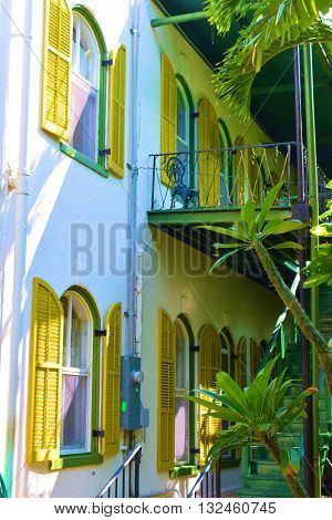May 22, 2016 in Key West, FL:  The Ernest Hemingway House built in 1851 which is a National Historic Landmark where people take tours and is where Ernest Hemingway wrote his best novels surrounded by tropical plants taken in Key West, FL