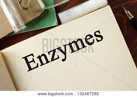 Enzymes written on a page. Chemistry concept.