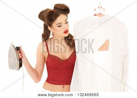 Young unhappy beautiful woman with shirt and iron on a white background. Housekeeping.