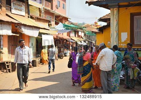 GOKARNA KARNATAKA INDIA - JANUARY 29 2016: Indian people comunicating in the street in Gokarna city