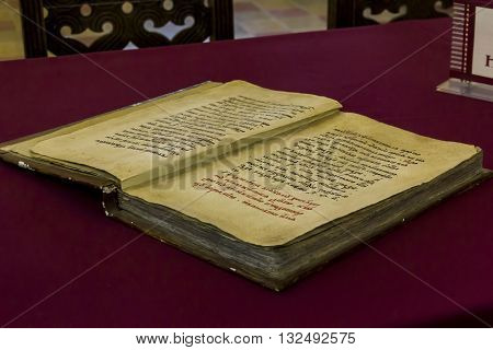 ROSTOV, RUSSIA - JUNE 3, 2013: It is an ancient manuscript book in the Rostov Kremlin Museum.