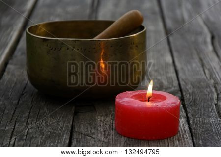 Singing Bowl And Burning Red Candle
