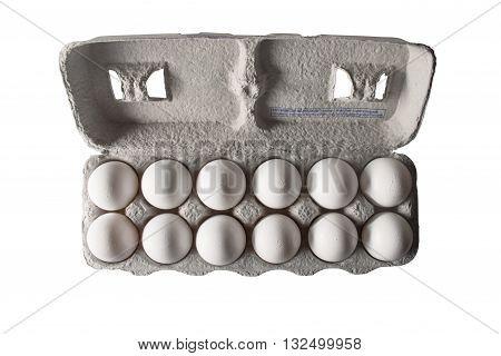 An egg carton with a dozen white eggs from overhead.