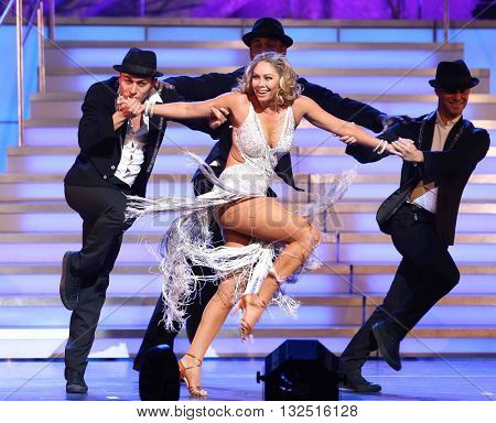 NEW YORK-JAN 12: Keo Motsepe (2nd L), Kym Johnson and Sasha Farber (R) perform at Dancing with the Stars: Live! Tour at the Beacon Theatre on January 15, 2015 in New York City.