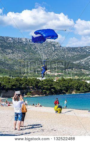 Brac Croatia - May 07 2016: parachutist landing on Zlatni Rat beach Croatia