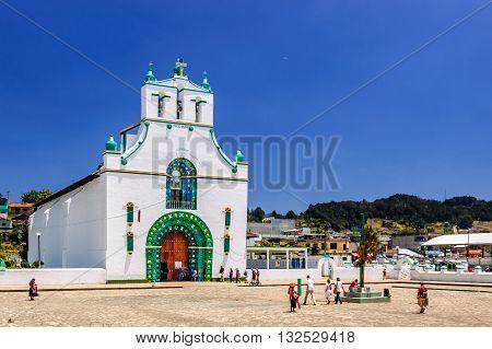 Chamula Mexico - March 25 2015: Ornate exterior of Templo de San Juan Bautista in Chamula an indigenous town with unique autonomous status in Mexico & no outside police force near San Cristobal de las Casas Chiapas