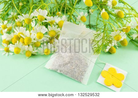 Chamomile Flowers And A Chamomile Tea Bag