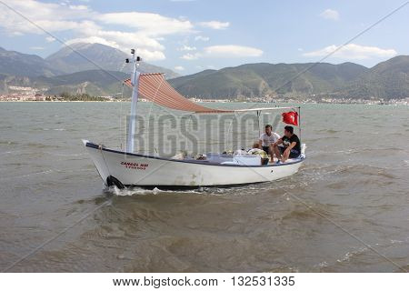 26TH MAY 2016, FETHIYE, TURKEY: Two unknown fishermen in a small fishing boat in the bay of Fethiye in turkey, 26th may 2016