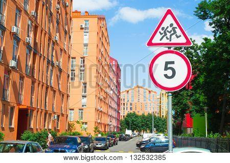 Road sign caution children, 5 km speed limit sign near the school