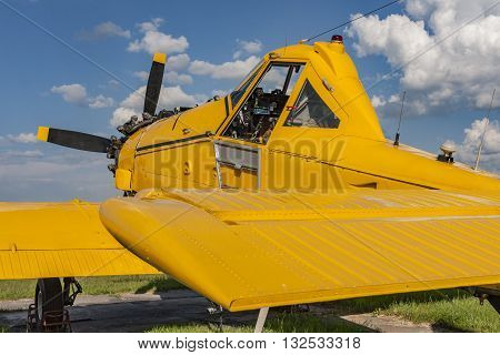 Yellow agricultural aircraft ready for flight visible cockpit