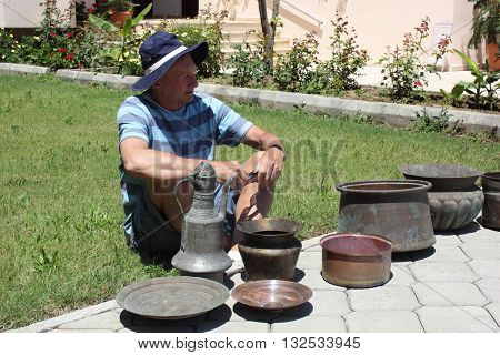 28TH MAY 2016, CALIS, TURKEY : An Englishman with his purchase of old antique copper pots which he bought in Calis in Turkey, 28th may 2016