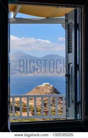 MELOS GREECE - SEPTEMBER 3 2012: Church of Prophet Elias up on a hill below the village of Plaka