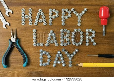 Labor day concept sign. Happy labor day - writing screws.