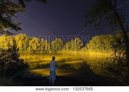 Fisherman in night , Night Fishing, Carp Rods, starry night reflection on lake