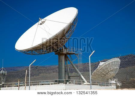 Satellite dish antennas with blue sky.Satellite dish antennas, Spain.