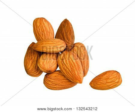 Almonds isolated on white background. Fresh raw almonds. Vegetarian food nuts. Almond nuts isolated on white. Group of brown fresh almonds.