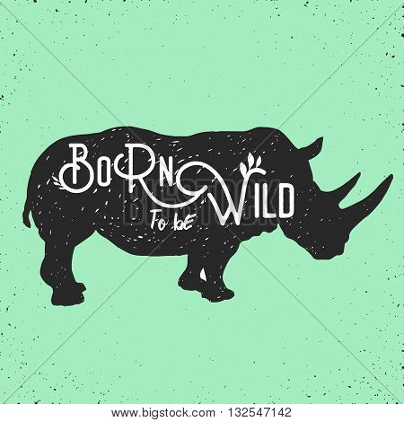hand drawn silhouette of mighty wild rhino and motivation quote on it