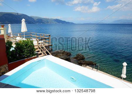 The swimming pool near beach at luxury hotel Corfu Greece