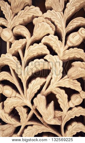 Floral clay carving sienna pattern ornament. Flower wall decoration black and ocher background