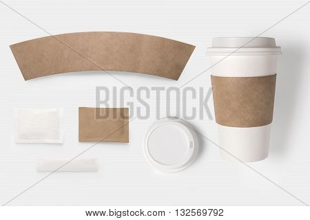 Design Concept Of Mockup Paper, Sugar, Coffee Creamer, Toothpick, Lid And Coffee Cup Set On White Ba