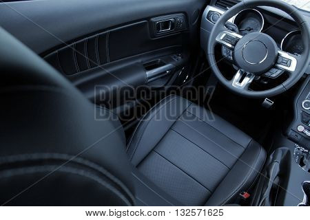 Sport seats with lateral support in leather car interior
