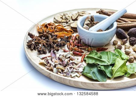 A photo of Herbal medicine in wood dish on white isolate background with space for text