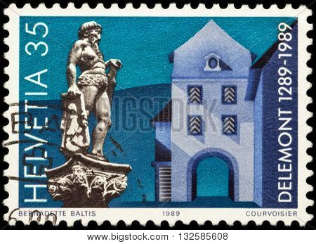 MOSCOW RUSSIA - JUNE 02 2016: A stamp printed in Switzerland shows ancient Swiss city Delemont devoted to the 700th Anniversary of Delemont circa 1989