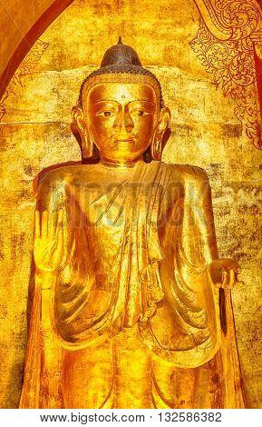 Buddha statue in Ananda temple in Bagan. Myanmar.