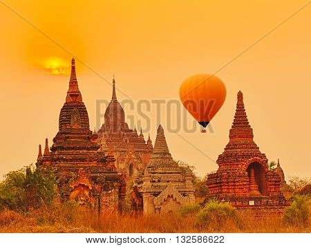 Balloons over Htilominlo Temple at sunrise in Bagan. Myanmar.