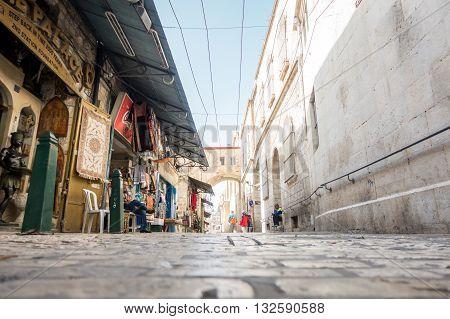 Shopkeeper And Tourist On Narrow Street Of Jerusalem
