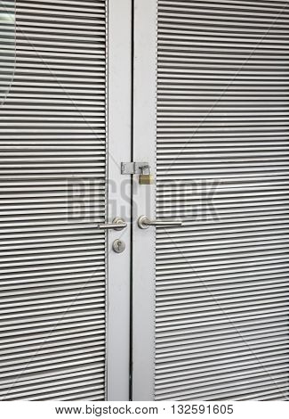 Steel stripped texture locked door stock photo