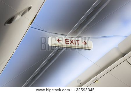 Airplane cabin interior exit sign stock photo