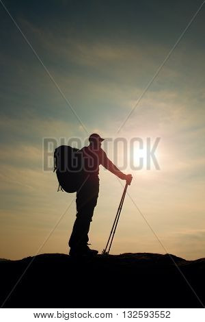 Tourist In Windcheater With Sporty Trecking  Poles In Hands Stand On Rocky View Point.